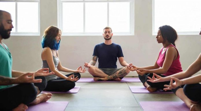 Practicing group yoga is good for body and soul